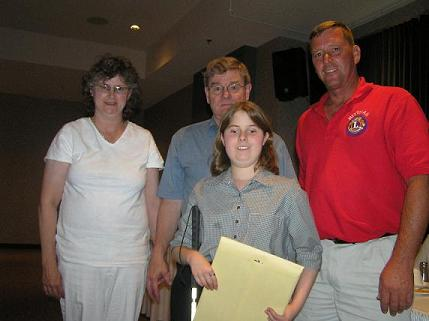 Mary Krumwiede, her parents and President Dave Simpson of the Rittman Lions