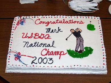 "Picture of the cake that reads, ""National Champion 2003!"""